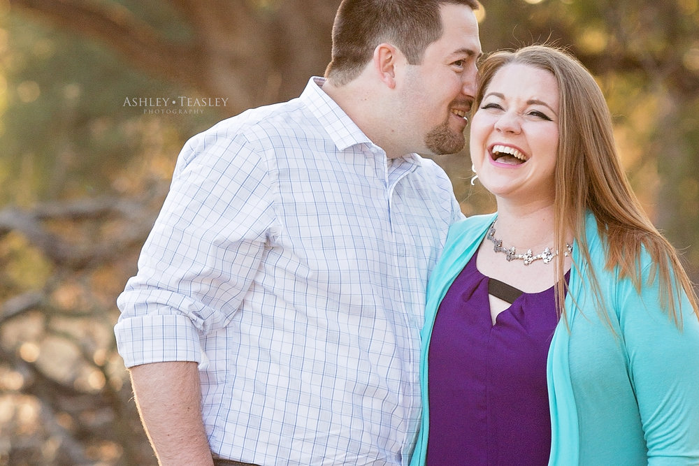 Folsom Ca | Sunset Golden Hour | Man whispers in fiancé's ear | Laughing | Engagement Session | Folsom & Sacramento Wedding Photographer