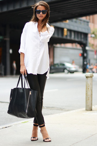 White tunic shirt and black leather pants with black bag and shoes for a simple street style