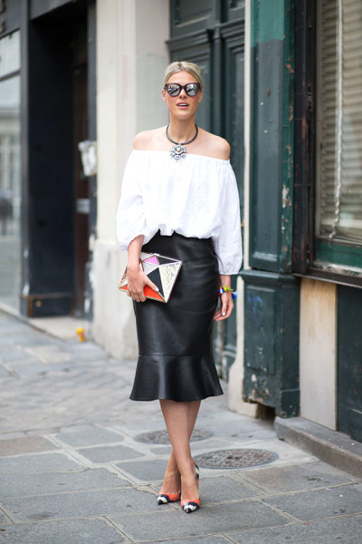 Off-shoulder white top and fishtail black leather skirt and in perfect proportions
