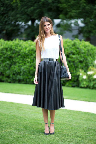 White top and pleated skirt in black