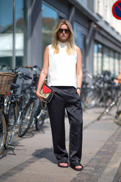 White tank and black satin and slouchy pants