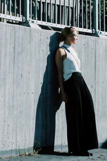 Funnelneck white tank and black wide leg pants