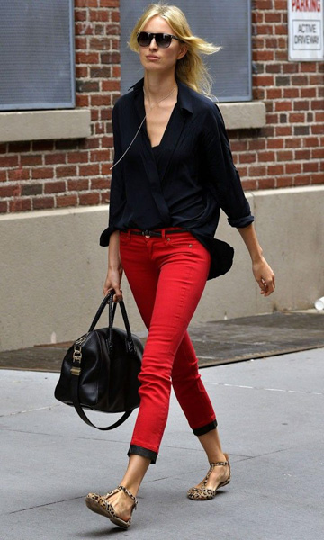 Red chinos and tucked black wrap shirt