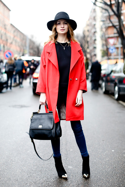 Red cocoon coat with black top and hat