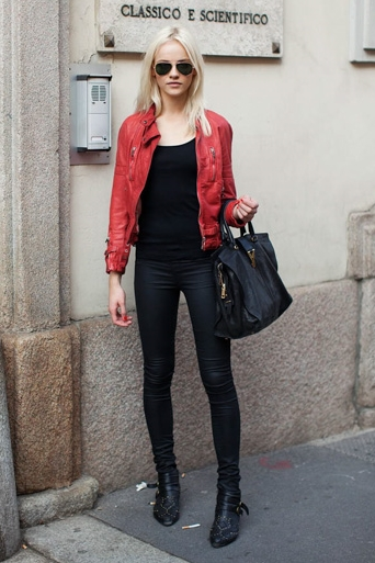 Red leather jacket over black top and jeans