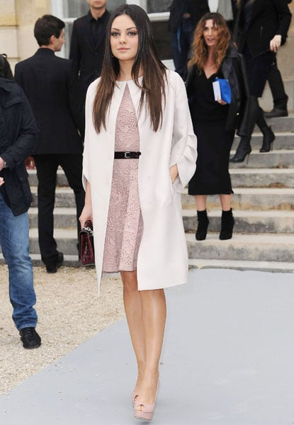 White coat and pale pink lace dress with black belt