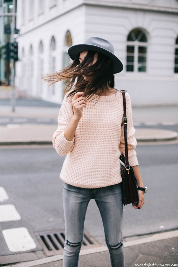 Ripped grey denim and pale pink knit