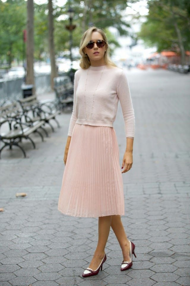 Pink sweater and pleated skirt