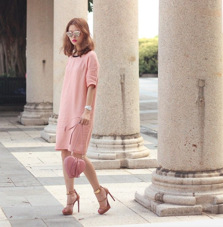 Pink with different shades in sweater dress, bag and pumps