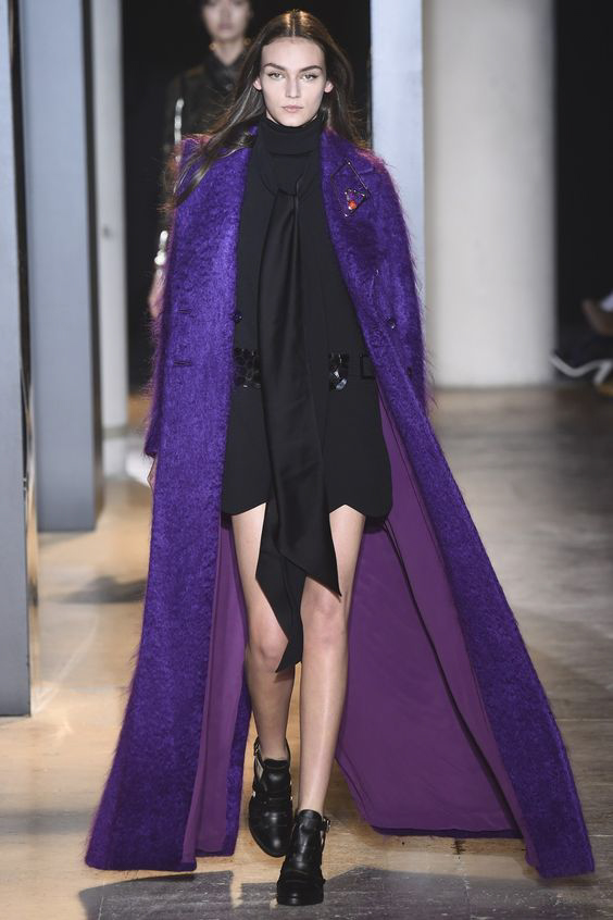 Long purple coat and black mini dress from John Galliano