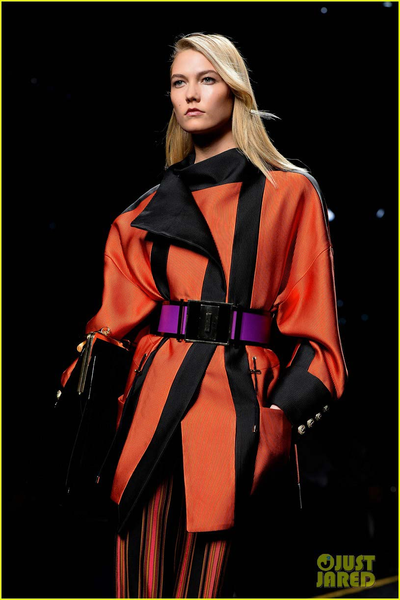 Oversize orange coat with purple belt