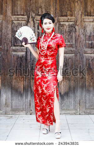 Chinese Woman Wears China Red Traditional-Cheongsam (Credit: Shutterstock)
