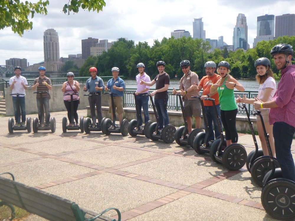 The Assessment Systems team enjoying a Segway tour of their neighborhood along the Mississippi River.