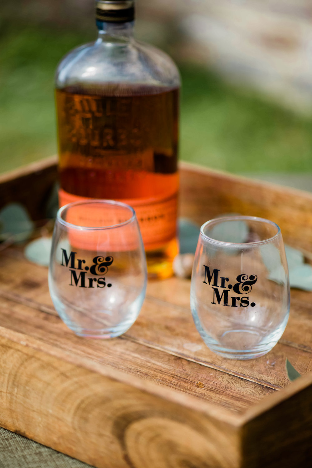 The most adorable Mr. and Mrs. wedding glasses with a side of Kentucky bourbon! Perfect addition to any winter wedding in the south!