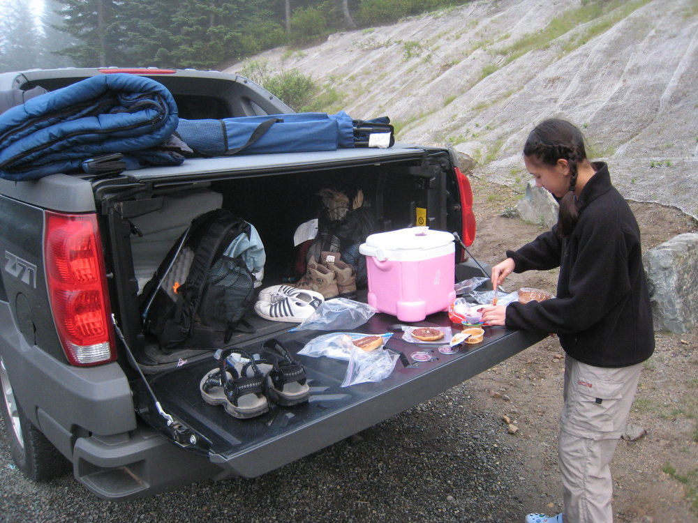 My daughter prepping breakfast before a St. Helens climb, 2007.