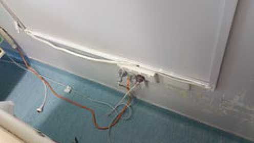 Non-recessed power in the vicinity of adjustable beds is typically a hazard that could be addressed as a result of a property audit