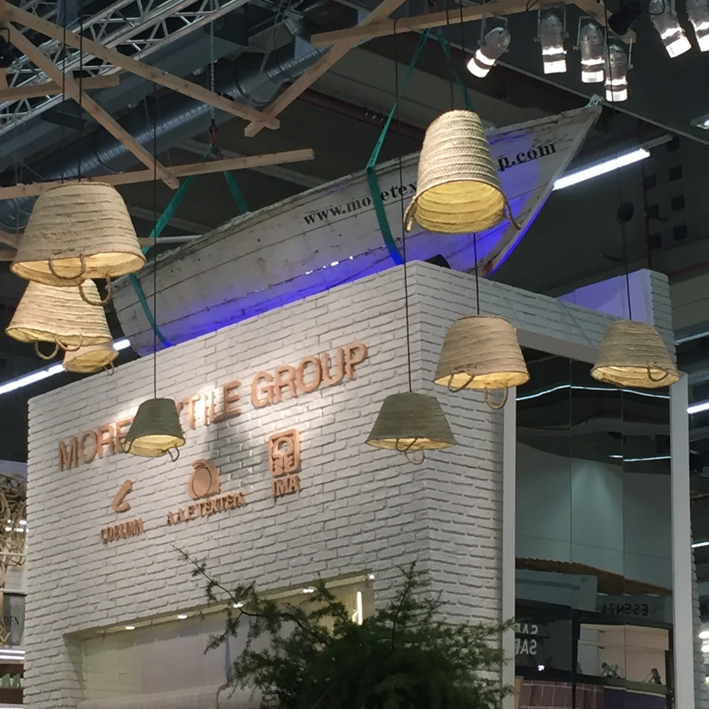 Straw totes as pendant lights -- and a boat on top of the booth!