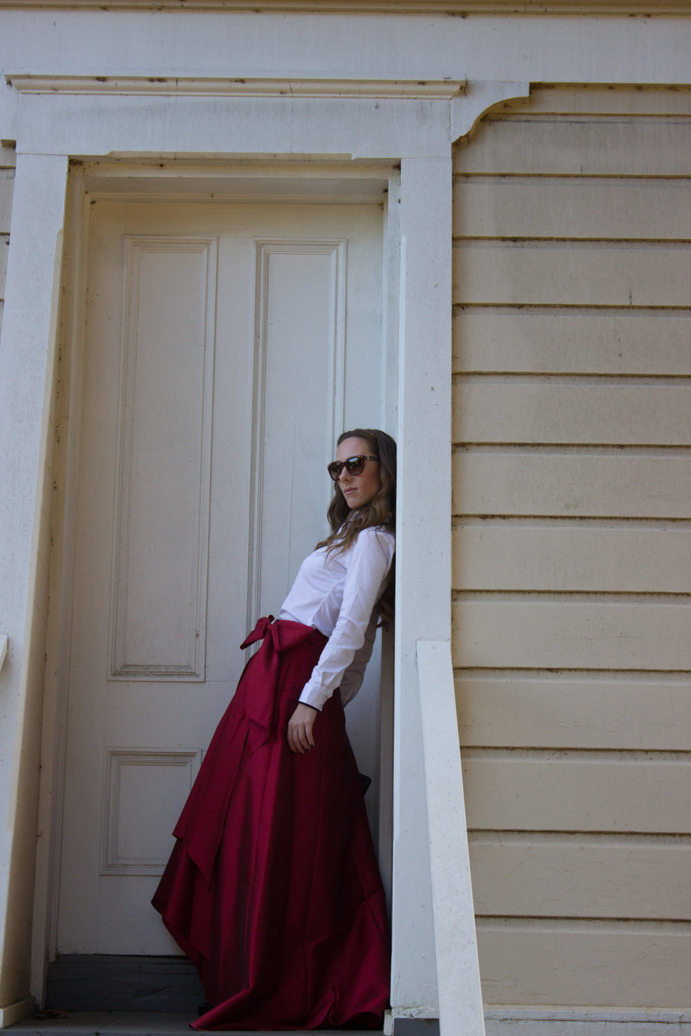 leaning-in-doorframe-ball-skirt.jpg