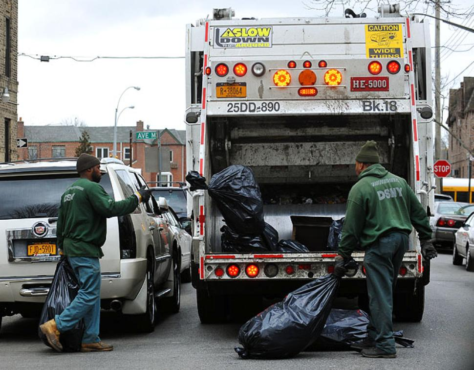 DSNY workers on the streets of New York. (Credit: Todd Maisel/New York Daily News)