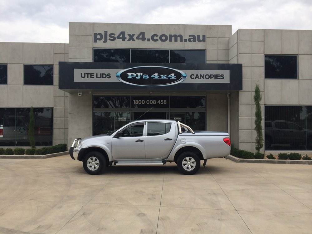Mitsubishi Triton Top Up Lid with Styling Bars Silver 1.JPG