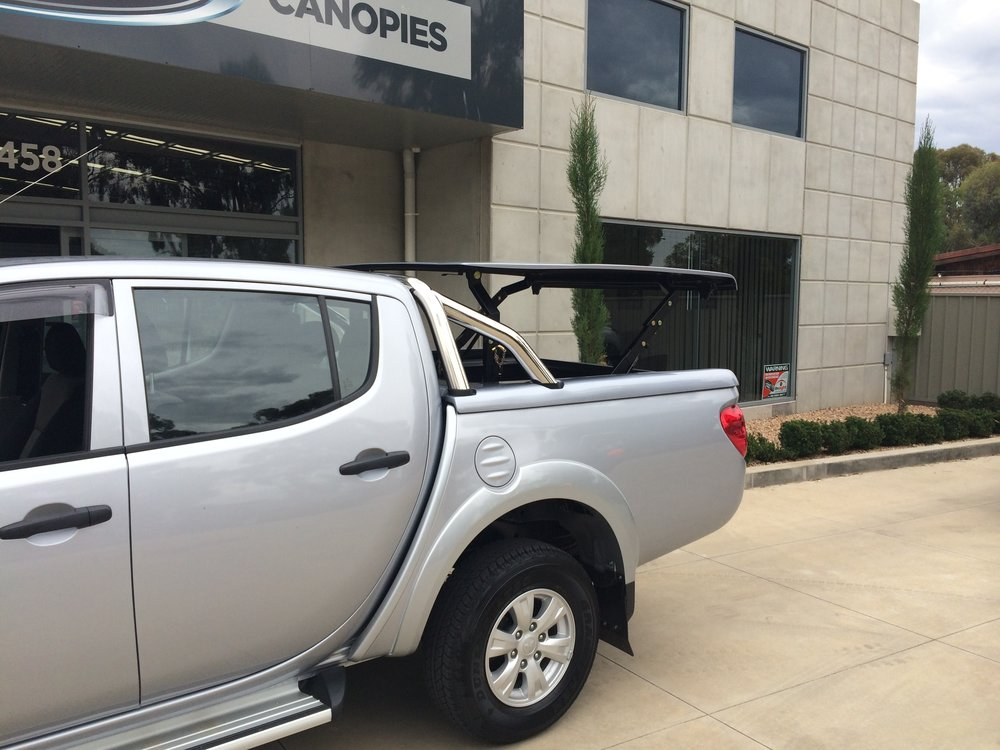 Mitsubishi Triton Top Up Lid with Styling Bars Silver 5.JPG