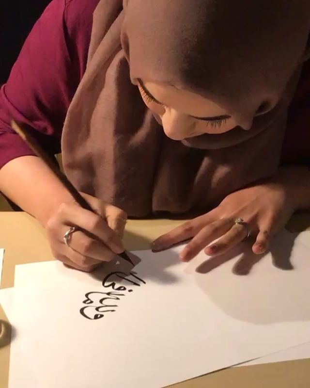 "A quick video from my live demonstration yesterday at our art exhibition, Calligraphies in Conversation. Alongside me were other calligraphy artists representing English, Chinese, Japanese, and Vietnamese calligraphy.  I wrote the following verse in a circular composition: ""Unto God belongeth whatsoever is in the heavens and whatsoever is in the earth, and unto God all things are returned."" (3:109)"