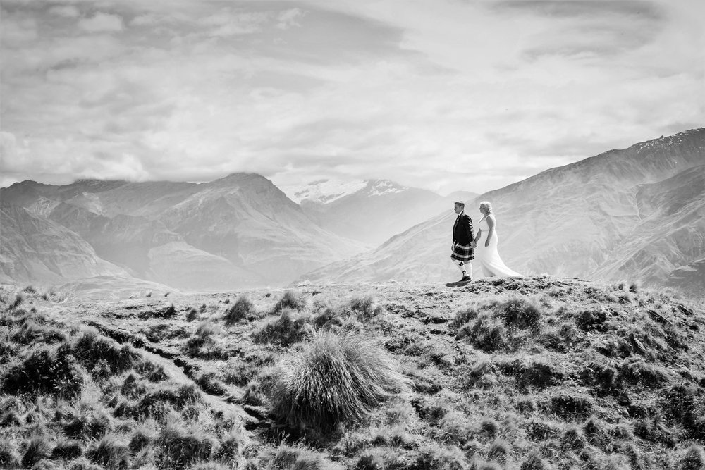 Black and White Portrait of newly married couple walking along Coromandel Peak in New Zealand