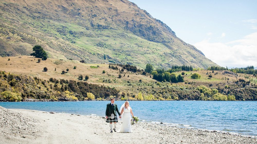 Married couple walks along south shore of Lake Wanaka