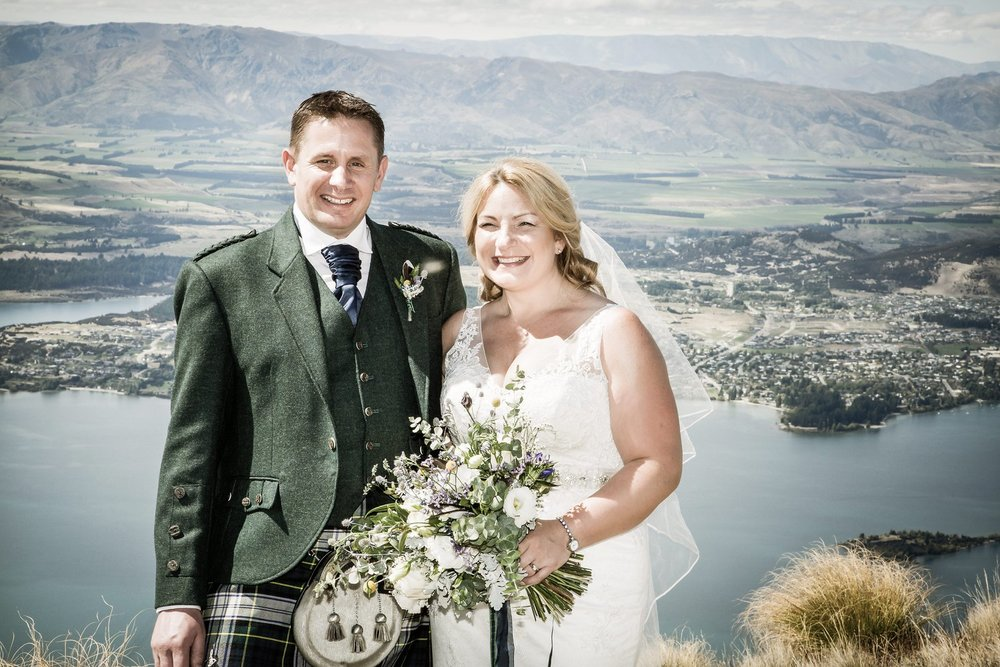 Bride and groom smile for portrait by Ruth at Fluidphoto