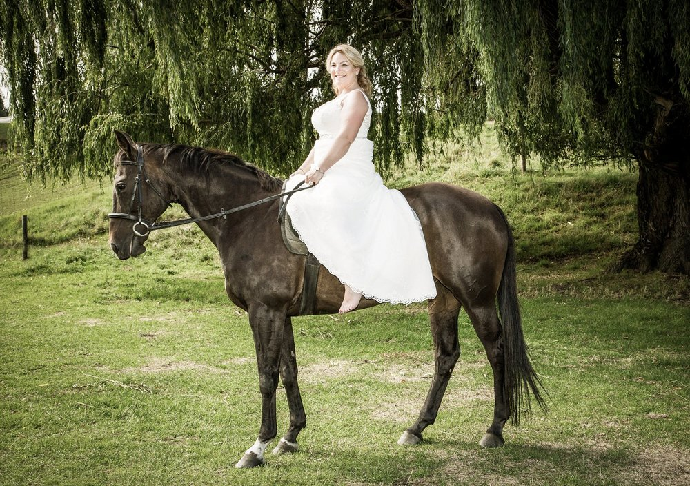 bride rides horse bareback at Waterfall Equestrian Centre in Wanaka New Zealand