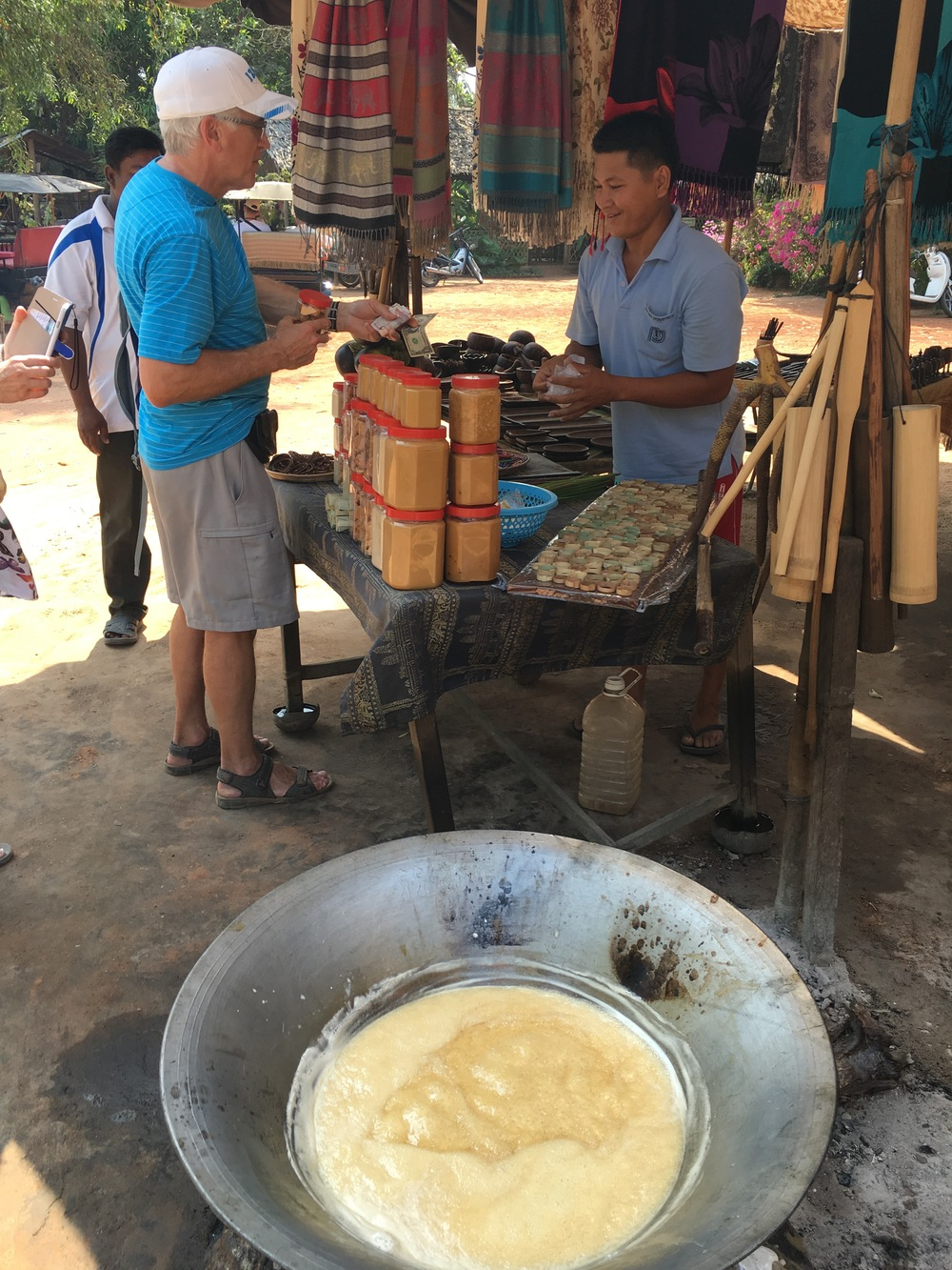 Dad paying for some Khmer candies