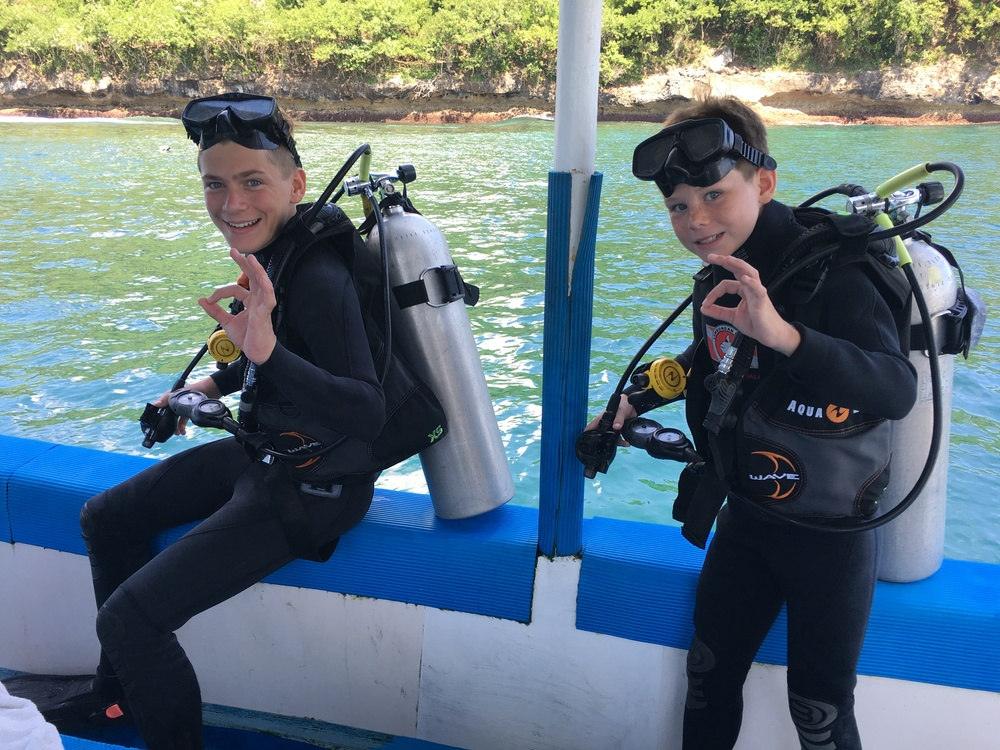 Brave scuba diving kids with cool parents
