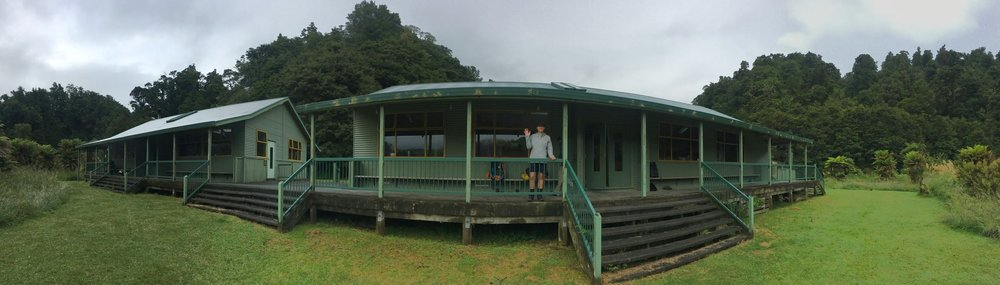 Shelley gives a wave goodbye from the deck of the Waiharuru Hut before we set off for our last few kilometres...