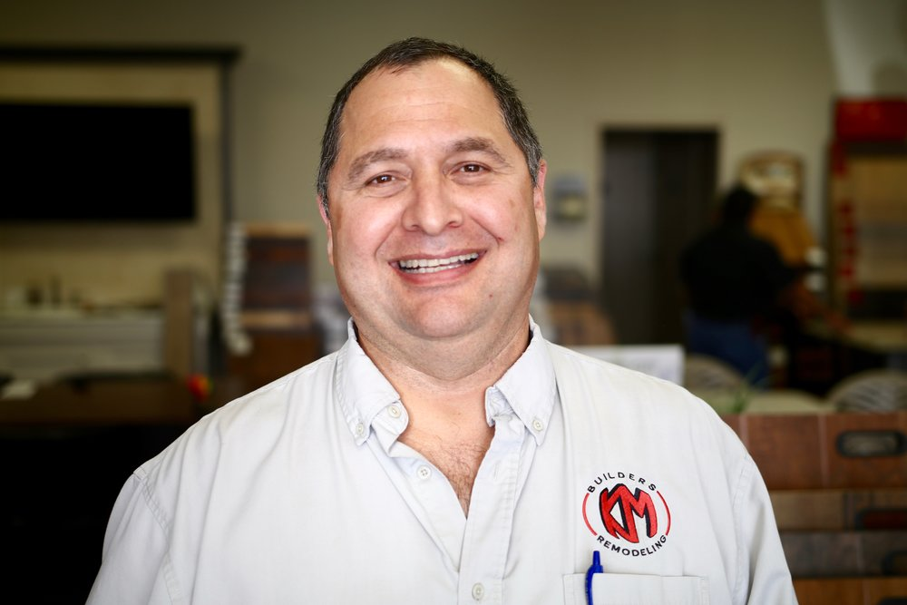 "Jaime PerezPurchasing Manager - Jaime has been at KM BUILDERS for 8 years and worked in Human Resources and IT departments. Jaime was born in French Camp, California, but moved to Sullivan City, Texas when he was four-years-old. Jaime likes Hard Rock music, Harrison Ford movies, and the Green Bay Packers! New York City is one of his favorite cities, and his motto is ""Treat others the way you want to be treated."""