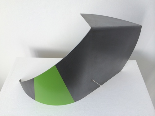 Selected for:Art Gemini Prize exhibition 2016   Title : Fabricated Green  Medium : Steel & Pigment  Dimension  s : 4 0 cm x 30 cm x 20 cm  I am exploring the boundaries between the natural surface of the steel and the imposed texture and colour. The fragility of the material is represented by a thin cut in the steel allowing a shaft of light through. While the curved shape appears like a defensive wall turned slightly inwards giving the structure strength and beauty.