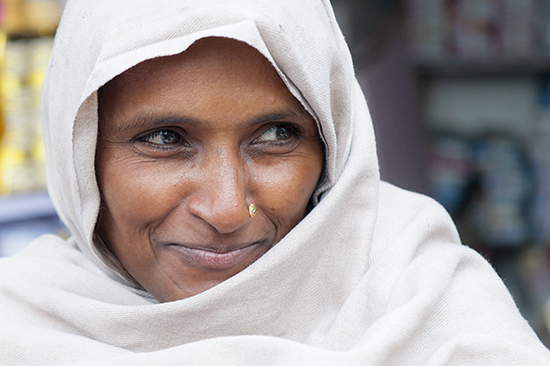 Lady on street side in Agra, India