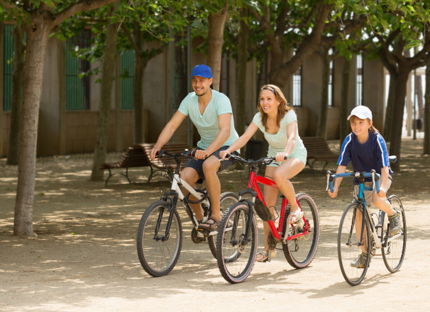 happy-family-of-three-cycling-on-street-road_1398-4068.jpg