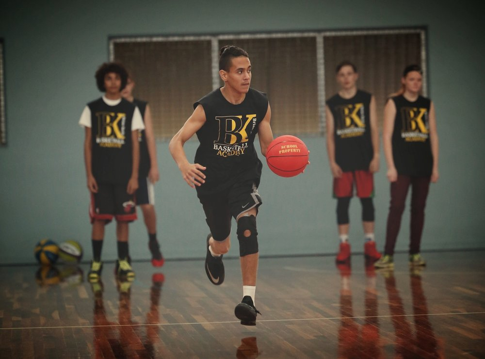 YOUNG INDIGENOUS BASKETBALL ACADEMY - The Young Indigenous Basketball Academy is a skills, mentoring and support program designed to assist in the development of basketball pathways while supporting improvements in educational engagement and outcomes and employment opportunities for young Aboriginal and Torres Strait Islander basketballers.