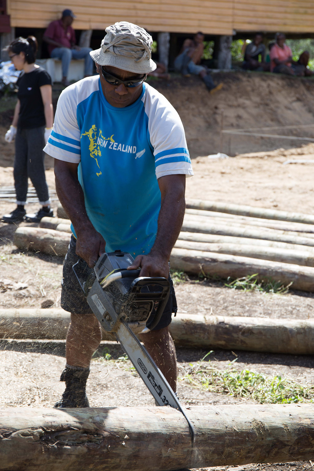 One of the locals in Naweni helping to cut the foundation poles