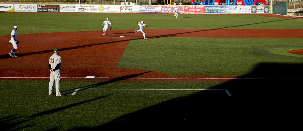 Fielding a ground ball.