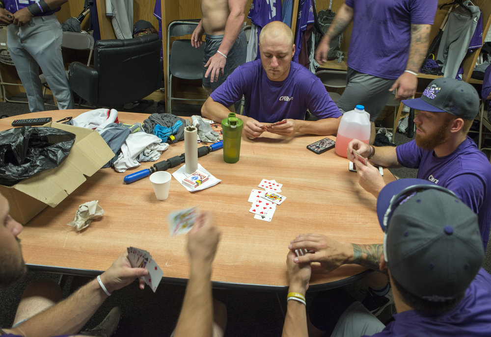 Playing cards in the clubhouse during a rain delay.