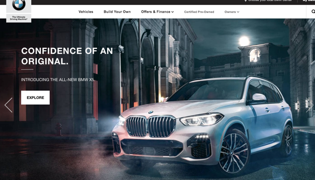 The BMW website shows a town car in a gothic style street, catering to the high-class, refined stereotype of Europe.
