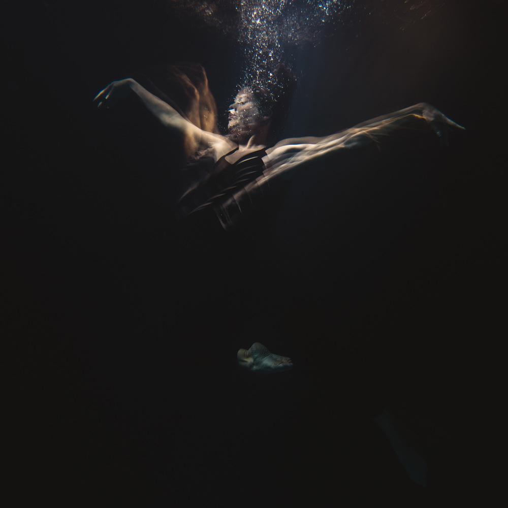 The light bounces of this dancer underwater creating unique shapes. ©- Matt Porteous