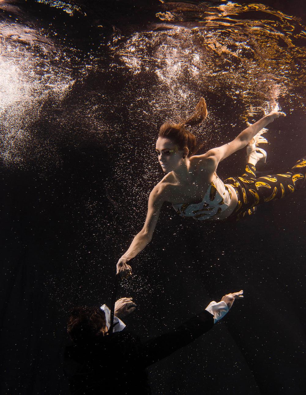 Incredible light captures this dancer duo underwater. ©- Matt Porteous