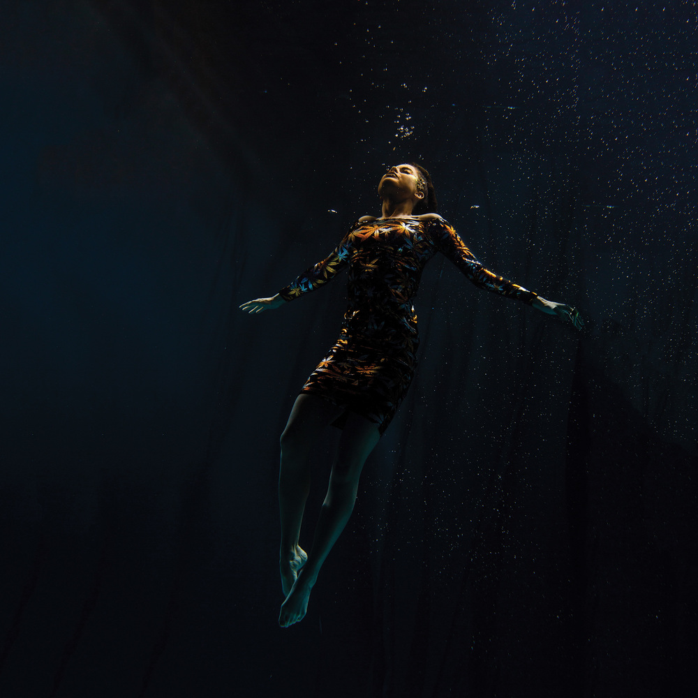 This underwater image captures the floating sensation as a dancer drifts to the surface. ©- Matt Porteous