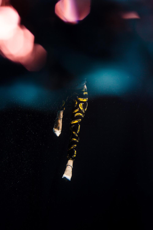 Vibrant colours bounce the light from a dancer underwater. ©- Matt Porteous