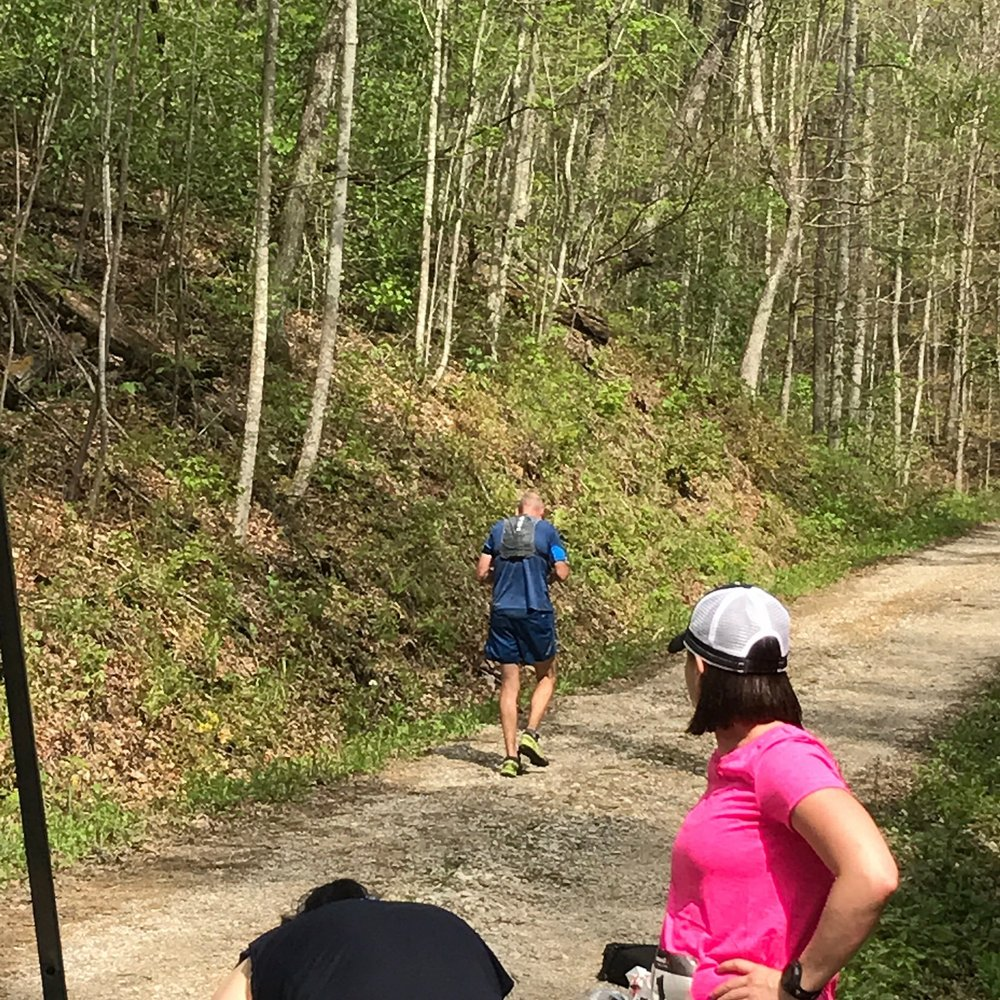 Runners head back up the grueling hill from the Elk Lick Aid Station.  Photo provided by Shannon Bryan.