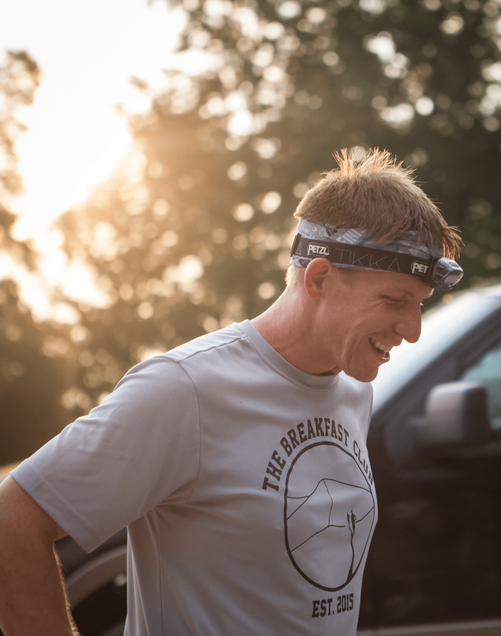 A beautiful sunrise greeted runners at the finish line on Sunday morning. Pictured here is 2nd place finisher Adam Rood. Photo by Clary Estes