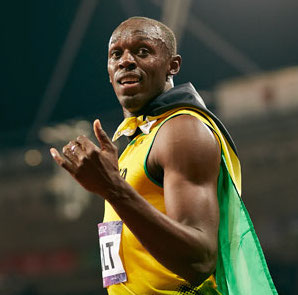 Don't tug on Superman's Jamaican flag cape. (Photo copyright IOC)