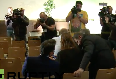 Camera capture Seb Coe (foreground, left) in audience at Thursday's press conference.